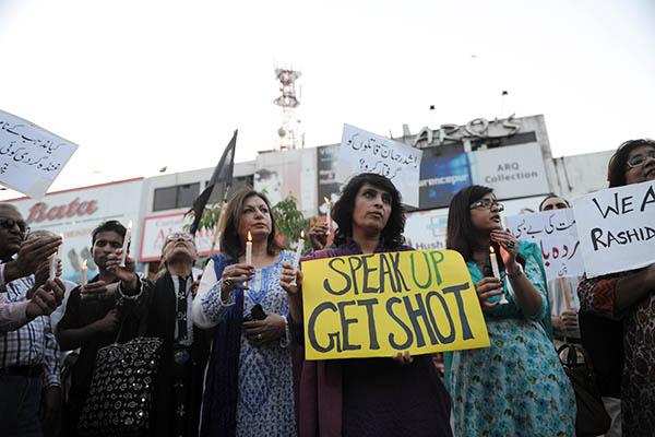 HRCP activists in Islamabad protest Rashid Rehman's killing. Aamir Qureshi—AFP
