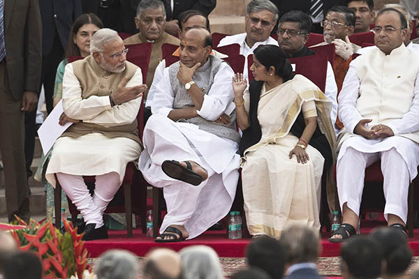 Narendra Modi talks to members of his newly inducted cabinet. Prakash Singh—AFP