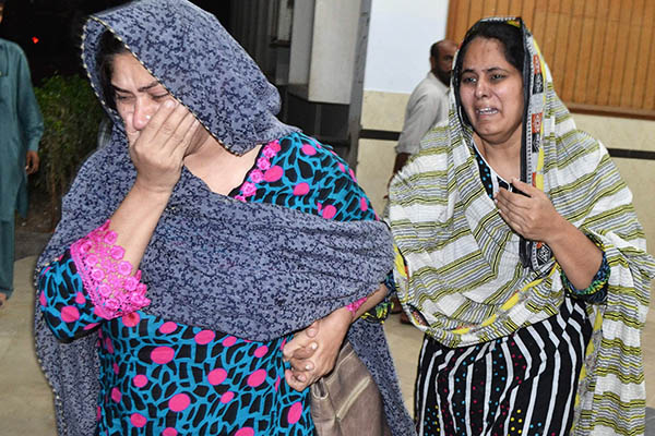 Rashid Rehman's relatives at hospital after his killing. SS Mirza—AFP