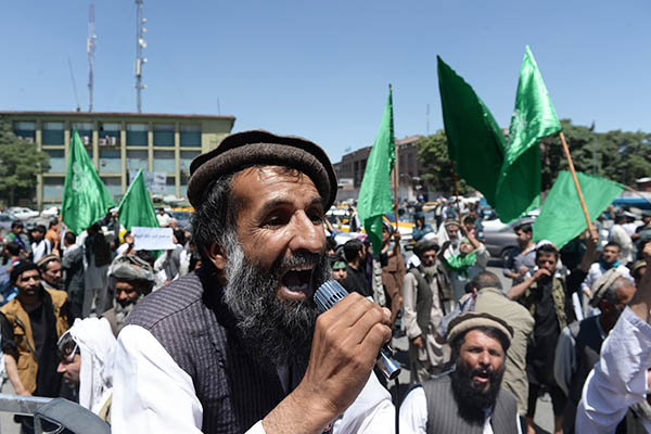 Supporters of Abdullah Abdullah protest against alleged electoral fraud. Shah Marai—AFP