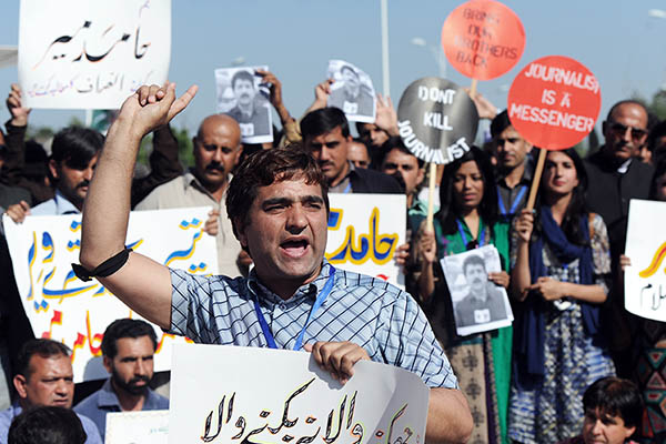 Journalists protest against the attack on Geo television anchor Hamid Mir, April 2014. Aamir Qureshi—AFP