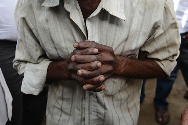 The father of one of the victims prays for justice. Chandan Khanna—AFP