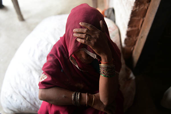 The mother of one of the girls gang-raped and hanged to death in Uttar Pradesh state. Chandan Khanna—AFP