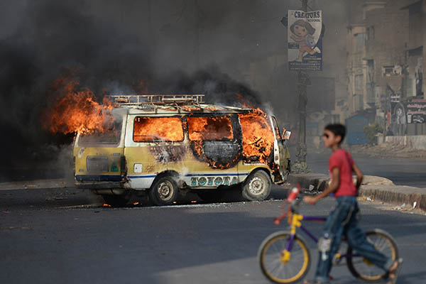 A truck set on fire by protesters after news broke of Altaf Hussain's arrest in London. Asif Hassan—AFP
