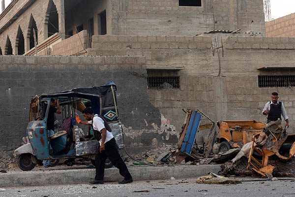 Police inspect the site of the explosion. Asif Hassan—AFP