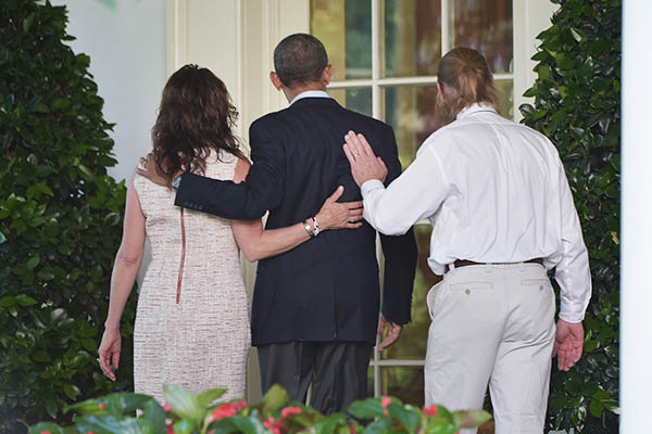 U.S. President Obama with Bob and Jani Bergdahl, the parents of freed U.S. soldier Bowe Bergdahl. Mandel Ngan—AFP