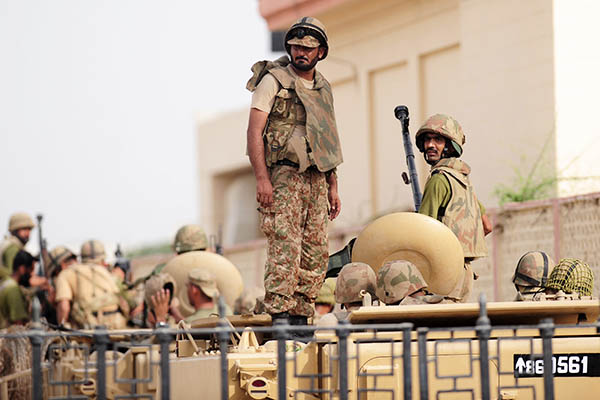 Army personnel stand guard at the Karachi airport after an assault that left at least 35 dead. Rizwan Tabassum—AFP