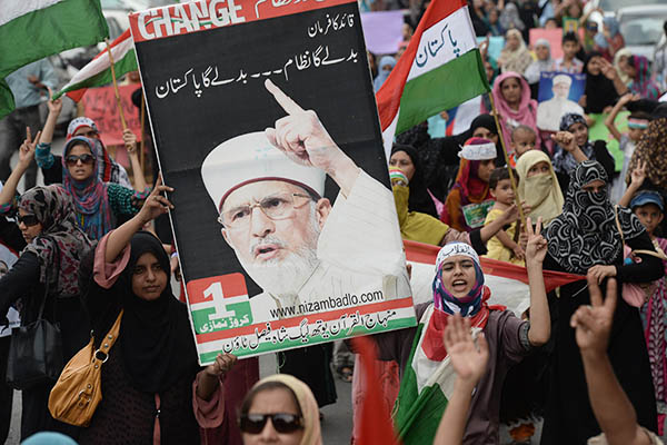 Supporters of Tahir-ul-Qadri protest the police brutality that led to the killing of eight people. Asif Hassan—AFP