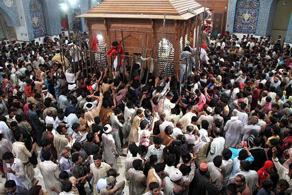 Devotees at the shrine in Sehwan. Yousuf Nagori—AFP