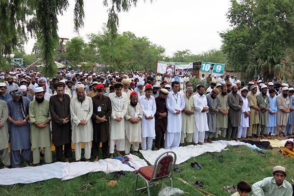 The internally displaced offer Eid prayers in Bannu. Karim Ullah—AFP