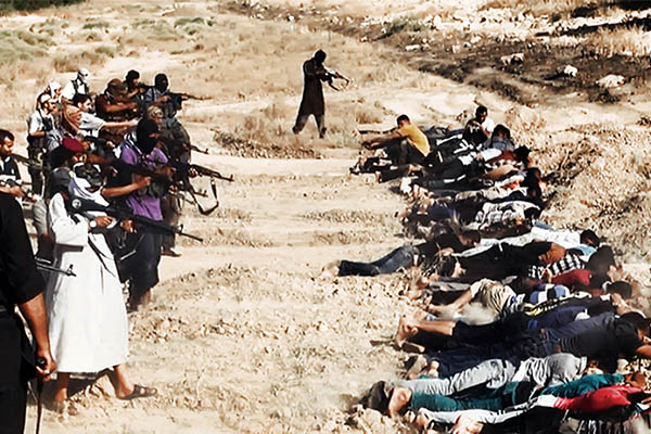 A screen grab allegedly shows ISIL militants executing Iraqi security forces personnel. Welayat Salahuddin—AFP
