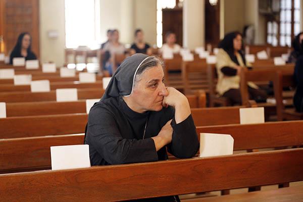 Christians attend mass in Baghdad. Sabah Arar—AFP