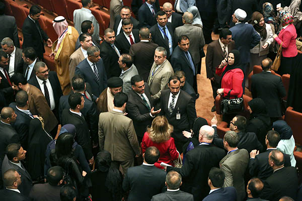 Members of the Iraqi parliament argue at the first session. Ahmad al-Rubaye—AFP