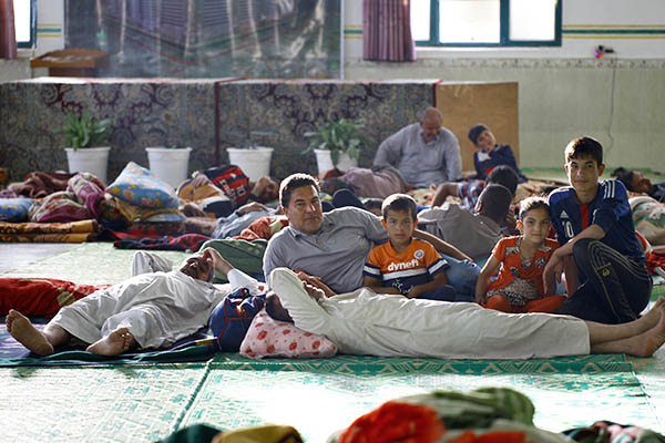 Refugees of the Islamic State's self-imposed sharia rest at a local shelter. Haidar Hamdani—AFP