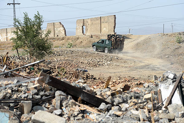 Pakistan Army soldiers patrol destroyed buildings in Miranshah. Aamir Qureshi—AFP