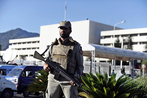 A Ranger stands guard outside the National Assembly. Farooq Naeem—AFP