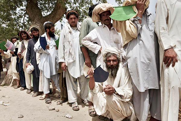 Internally displaced tribesmen queue up for food in Bannu. A. Majeed—AFP