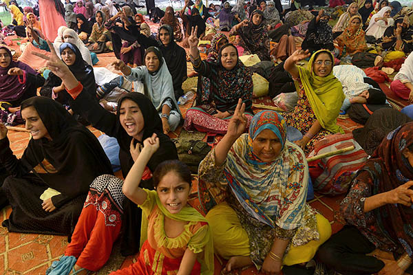 Tahir-ul-Qadri's supporters gathered outside his house in Lahore. Arif Ali—AFP