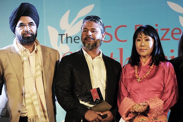 Karunatilaka (center) won the 2012 DSC Prize. Prakash Singh—AFP