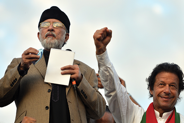 The two protest leaders united by a sound-system glitch. Aamir Qureshi—AFP