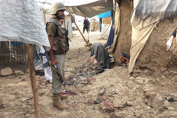 Security officials at the site of the bombing in Hangu. Basit Shah—AFP