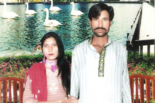 Shehzad Masih and Shama Bibi. HO—AFP