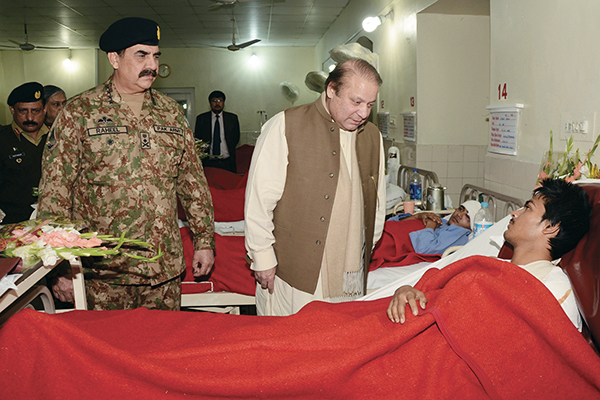 With Prime Minister Sharif in Peshawar, Dec. 17. ISPR/AFP