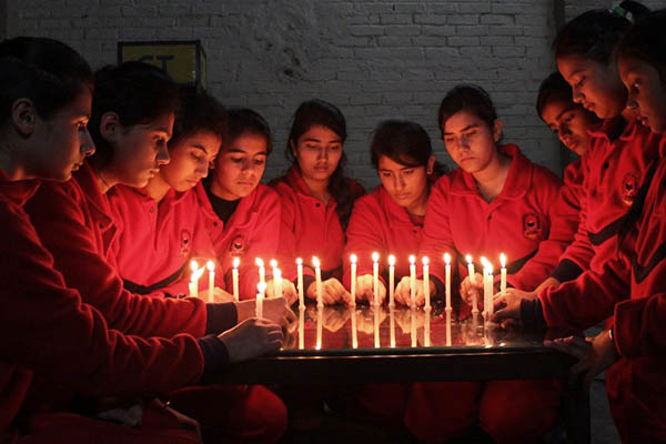 Indian schoolchildren hold a candle-lit vigil for the victims of the Peshawar siege. Shammi Mehra—AFP