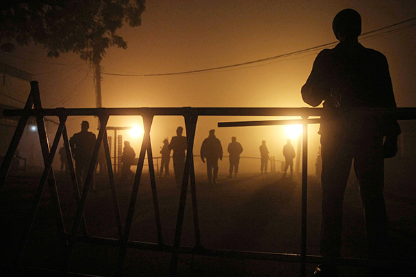 Pakistani troops on Jan. 7 outside a Multan jail where two Lashkar-e-Jhangvi members were executed. S. S. Mirza—AFP