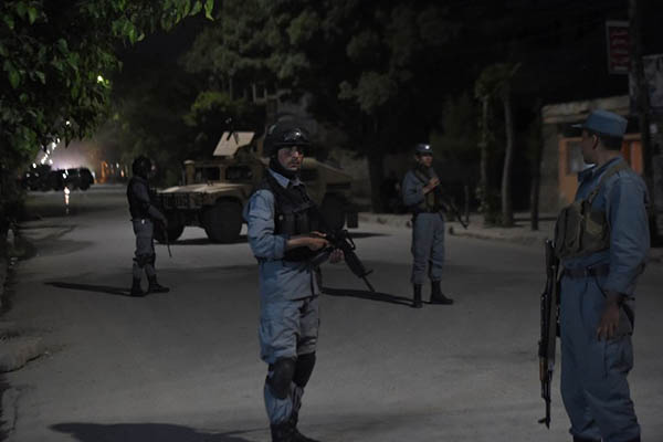 Afghan police outside the Park Palace guesthouse. Shah Marai—AFP