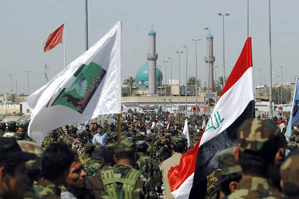 Iraqi fighters parade in Kufa. Haidar Hamdani—AFP