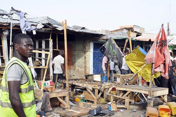 Rescue workers at the site of a March 10, 2015, suicide blast in Maiduguru. Olatunji Omirin—AFP