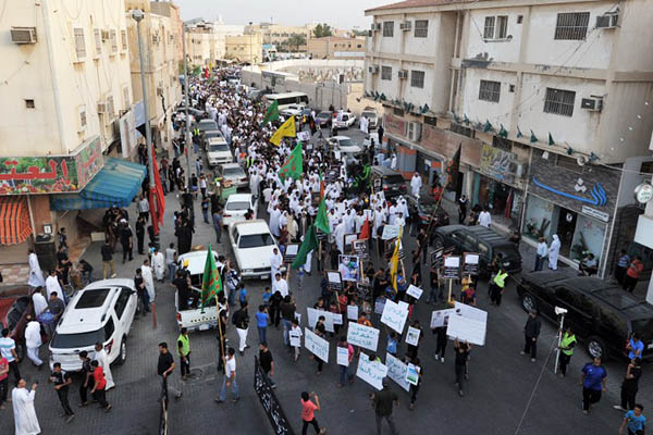 Saudis protest against the I.S.-claimed blast in Kudeih. Hussein Radwan—AFP