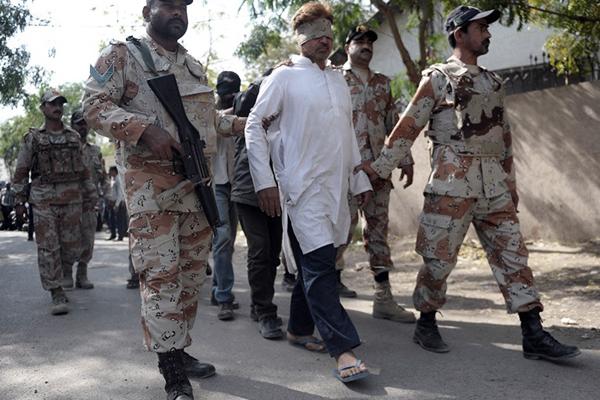 Rangers escort MQM activists to an antiterrorism court, Karachi, March 12. Rizwan Tabassum—AFP