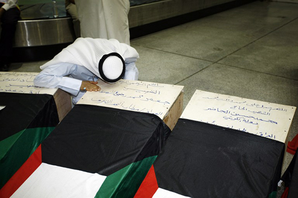 A Kuwaiti man mourns a relative killed in the Friday bombing, Najaf, June 27. Haidar Hamdani—AFP