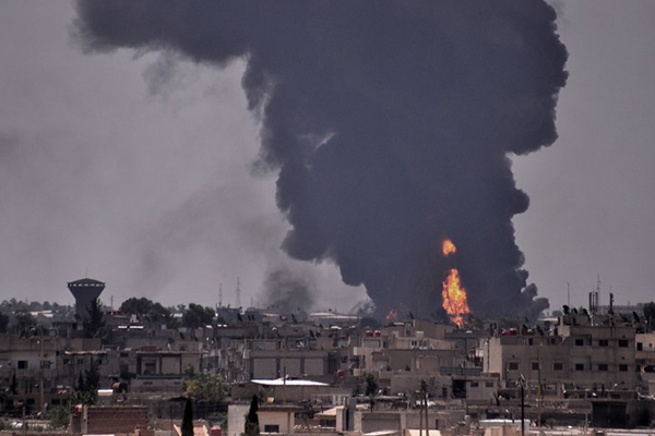 Smoke billows in the Syrian city of Hasakeh on June 28 following a mortar attack by I.S. Delil Souleiman—AFP