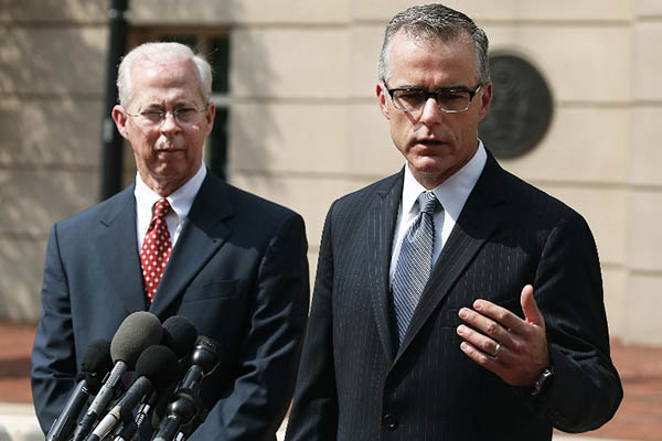 Andrew G. McCabe (right), assistant director of the FBI's Washington Field Office speaks after Amin's hearing. Mark Wilson-Getty Images North America—AFP