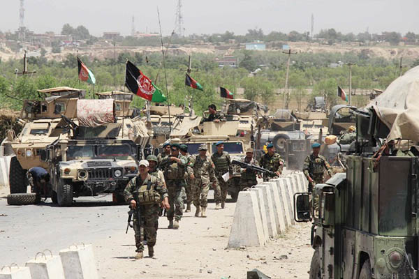 Afghan security forces travel through the besieged Chardarah district. Nasir Waqif—AFP