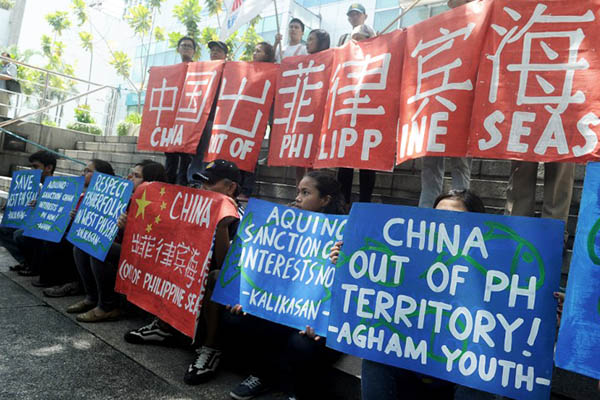Filipino activists protest China's activities in the South China Sea. Jay Directo—AFP