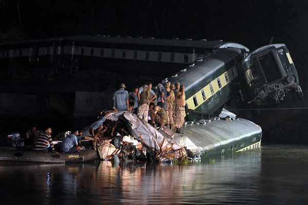 The rescue effort after the apparent accident, July 2. Arif Ali—AFP