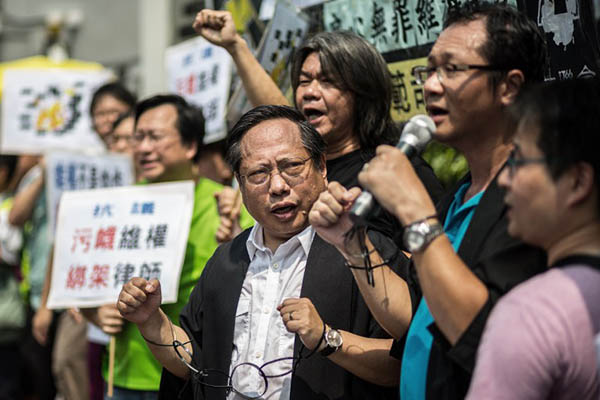 A protest in Hong Kong against China's crackdown on rights activists. Anthony Wallace—AFP