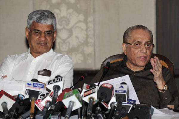 Board of Control for Cricket in India President Jagmohan Dalmiya (right) addresses a press conference with BCCI secretary Sanjay Patel on June 10, 2013. Sajjad Hussain—AFP