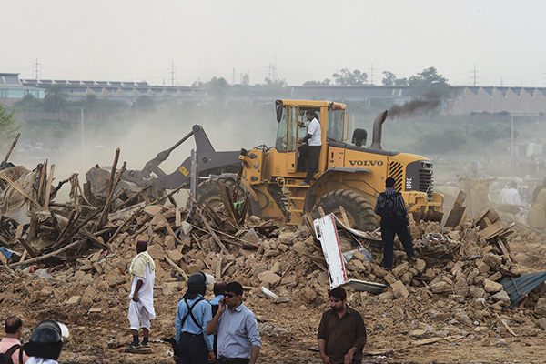 Legal action in Islamabad's I-11, July 30. Farooq Naeem—AFP