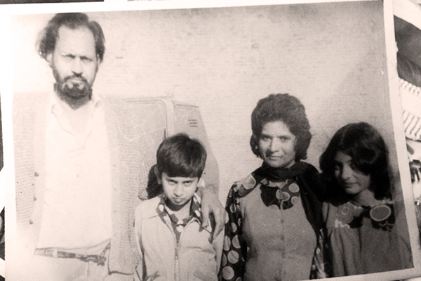 Hussein with his wife and children, who survive him, as do six grandchildren and three great-grandchildren.