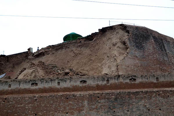 One wall of the historic Bala Hissar Fort lies in ruins after the earthquake.