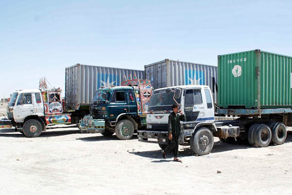 Shipping containers are the most popular—and cheapest—option for cross-border travel. Asghar Achakzai—AFP