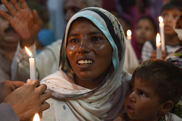 Shama Bibi's sister attends a protest against the mob lynching of her relatives. Arif Ali—AFP