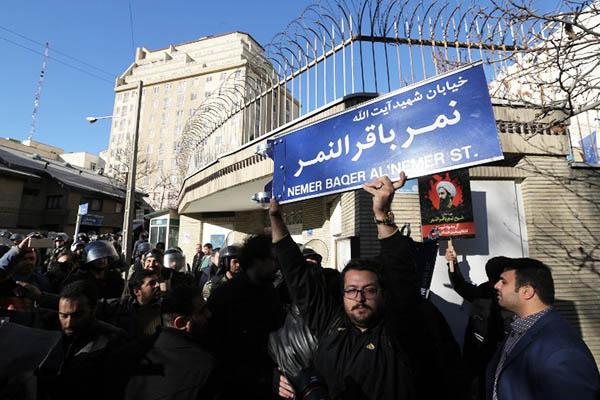An Iranian protester outside the Saudi embassy in Tehran. Atta Kenare—AFP