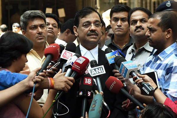 Indian public prosecutor Ujjwal Nikam speaks to media outside the sessions court in Mumbai. Punit Paranjpe—AFP