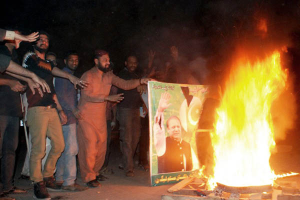 Pro-Qadri residents of Hyderabad protest against his execution. Yousuf Nagorai—AFP